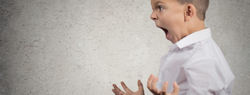 Closeup Headshot side view Portrait Angry Child Screaming, fists up in air. Expressing Anger, Rage. Transforming ADHD