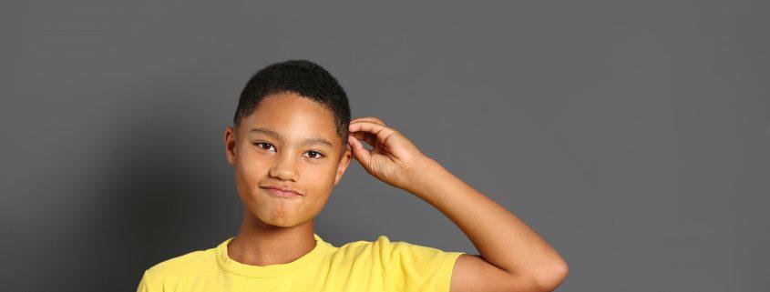 African American boy on grey background